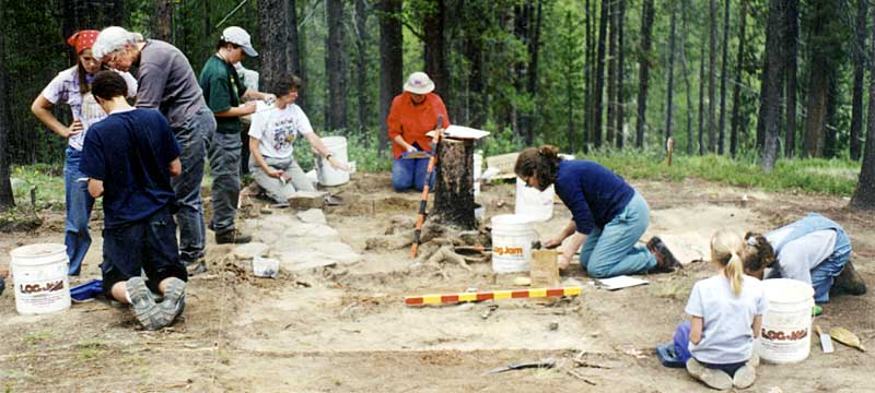 PIT volunteers uncover a hearth and small artifacts at the looted Fook Sing Company Mining Camp, 2001.